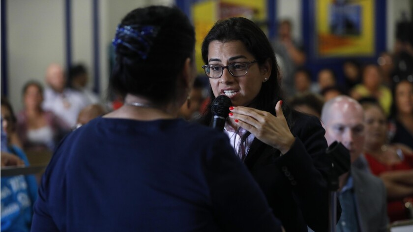 COMPTON, CA – JUNE 18, 2018 - Congresswoman Nanette Diaz Barragan , right, tries to calm the conce