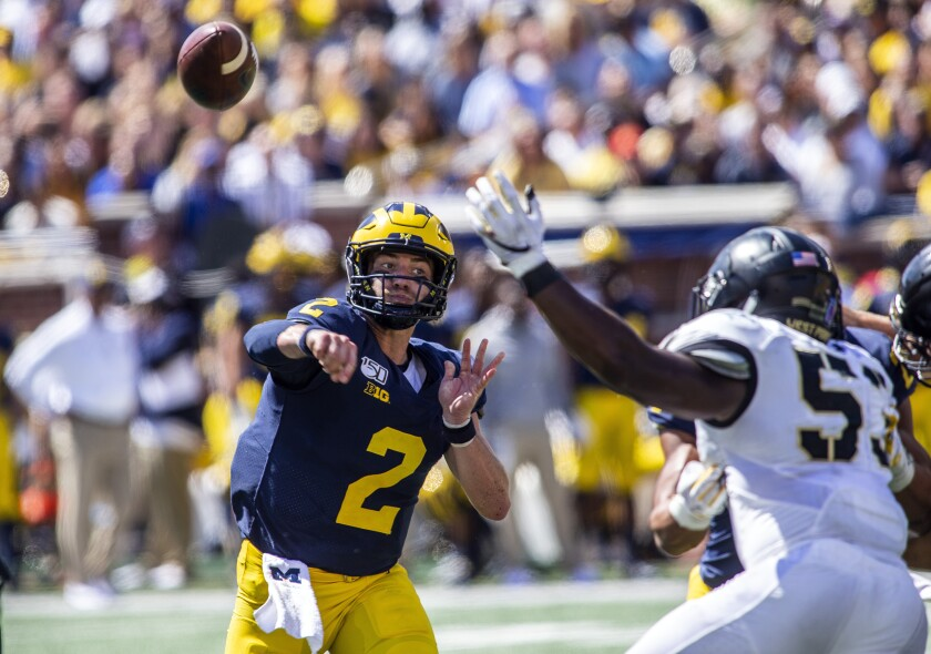 Michigan quarterback Shea Patterson delivers a pass against Army during the second quarter Saturday.