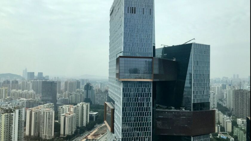The headquarters of social media giant Tencent hovers over Shenzhen's high-tech zone. Jeff Kearns /