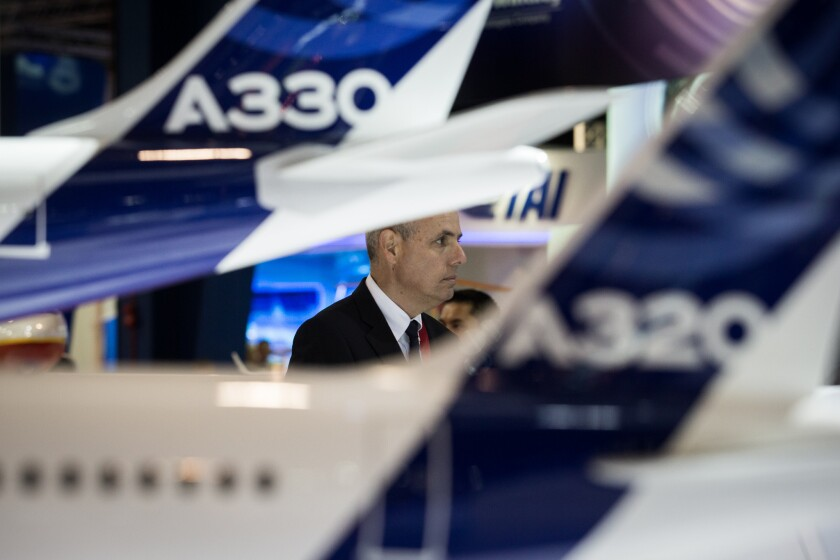 Models of Airbus aircraft are displayed at the Singapore Airshow.