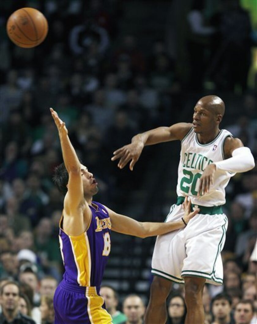 Boston Celtics' Ray Allen (20) passes over Los Angeles Lakers' Sasha Vujacic, of Slovenia, in the first quarter of an NBA basketball game, Sunday, Jan. 31, 2010, in Boston. (AP Photo/Michael Dwyer)