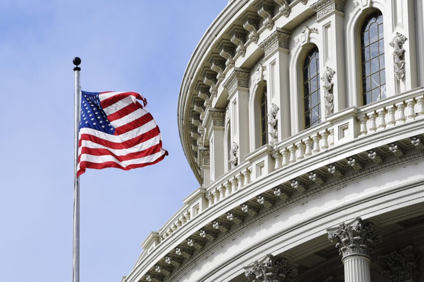 The American flag flies on Capitol Hill in Washington.