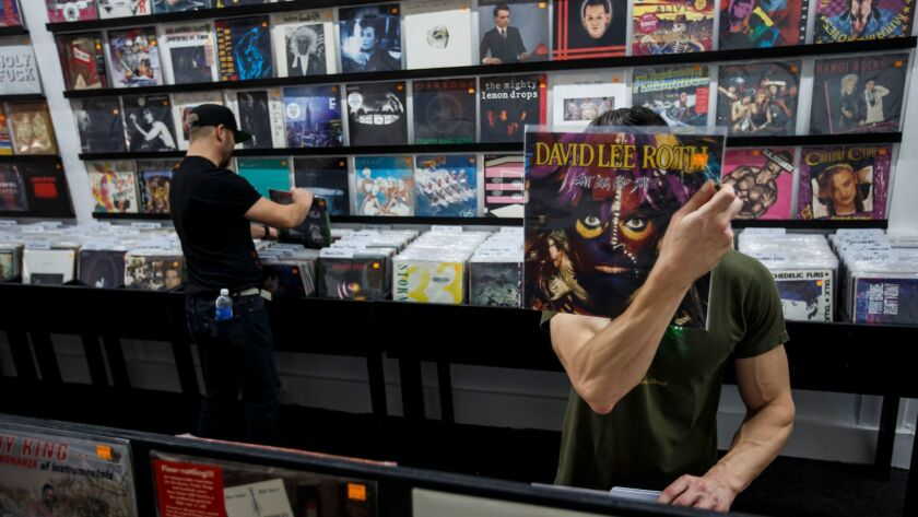 Vinyl shoppers at Pop Obscure Records in Los Angeles on Aug. 20.