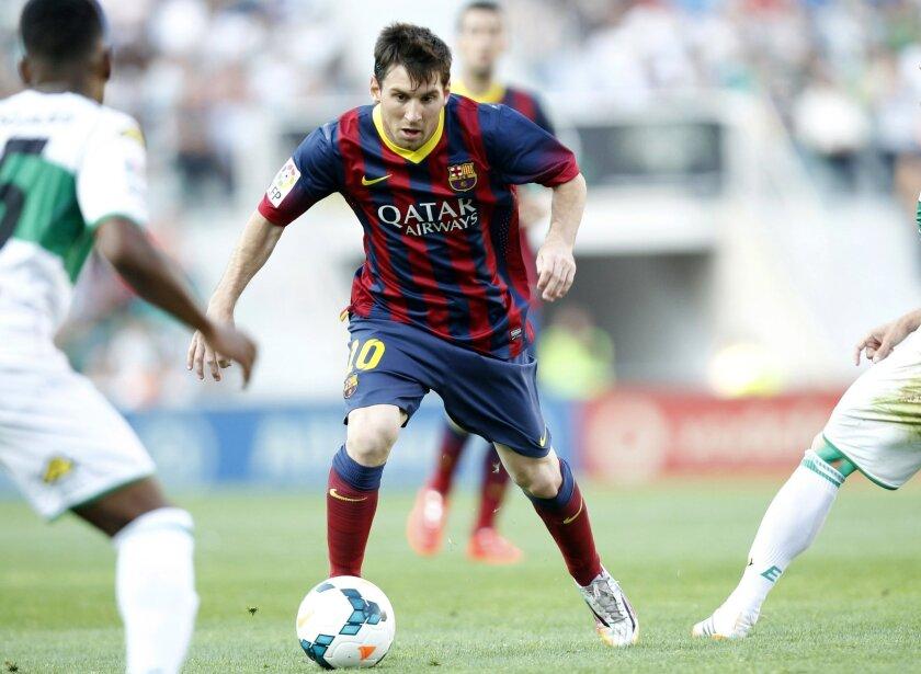 Barcelona's Lionel Messi from Argentina,  controls the ball past Elche's  Alberto Rivera Pizarro, left, during a Spanish La Liga soccer match at the Martinez Valero stadium in Elche, Spain, on Sunday, May 11, 2014. (AP Photo/Alberto Saiz)