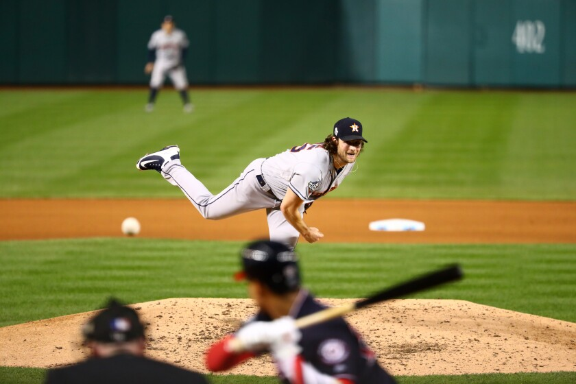 Houston Astros starter Gerrit Cole delivers against the Washington Nationals in Game 5 of the World Series on Sunday.
