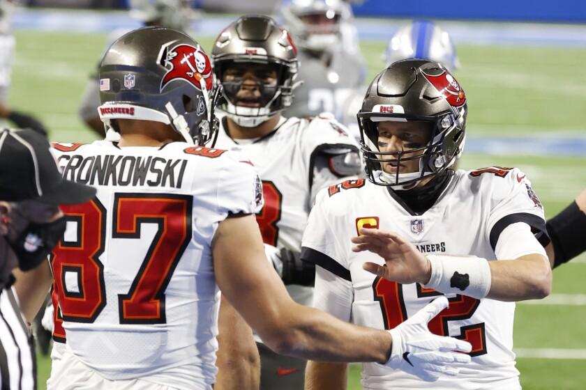 Tampa Bay Buccaneers tight end Rob Gronkowski celebrates with quarterback Tom Brady.