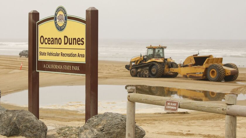"OCEANO, CA - JULY 03, 2019 - Entrance to the beach to access the ""Sand Highway,"" and the dune forma"