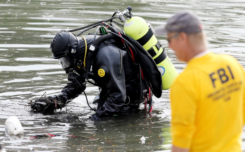 An FBI dive team searches Lake Seccombe, located about two miles north of the Inland Regional Center in San Bernardino, Dec. 10, 2015.