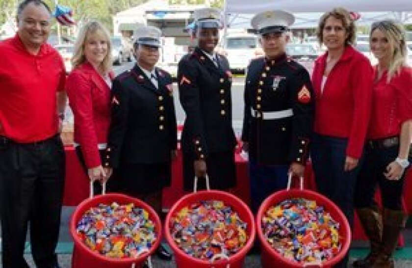 Again this year, military serviceman will be at the Candy Buy Back. (Dr. Curtis Chan is above left.)