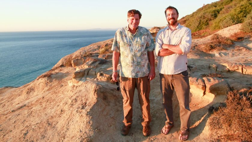 """Ed Gillet, 67, and Dave Shiley, 37, at the Torrey Pines Glider Port in La Jolla on Wednesday. Shively has written """"The Pacific Alone,"""" a book about Gillet's legendary 64-day solo voyage by sea kayak from Monterey to Maui in 1987."""