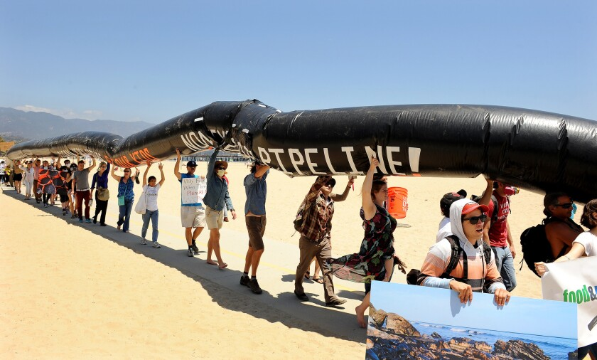 Concerned residents gather for a rally at the beach just south of the Santa Barbara oil spill site to call on Gov. Jerry Brown to ban fracking and other unconventional oil extraction methods that put California communities, the environment and natural resources at risk.