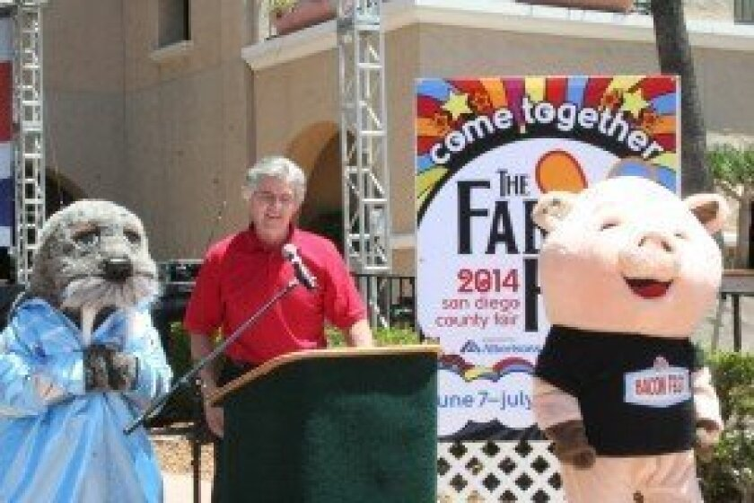 """Tim Fennell, CEO and general manager of the Del Mar Fairgrounds, highlights the food, fun and all things """"fab"""" at this year's fair during the May 21 press conference. He is pictured with Iam the Walrus and Pork Chop. Photos by Kristina Houck"""
