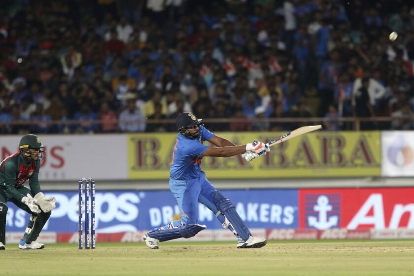 India's captain Rohit Sharma plays a shot during the second Twenty20 international cricket match against Bangladesh in Rajkot, India, Thursday, Nov. 7, 2019. (AP Photo/Ajit Solanki)