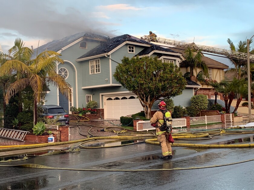 A three-alarm house fire broke out Tuesday on Huntington Harbour's Venture Drive.