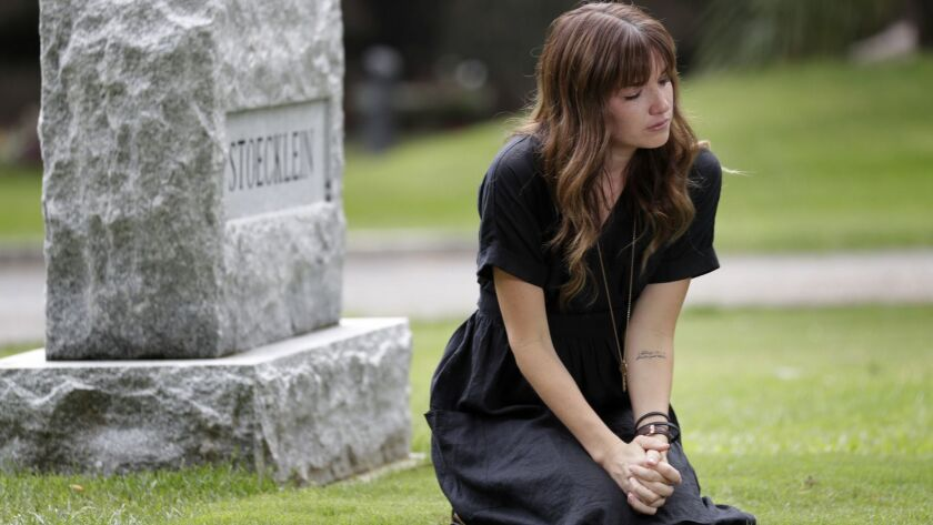 Kayla Stoecklein, 29, at the grave of her husband, Andrew, at a cemetery in Claremont, Calif. Andrew Stoecklein, who was lead pastor at Inland Hills Church in Chino, died by suicide in August.