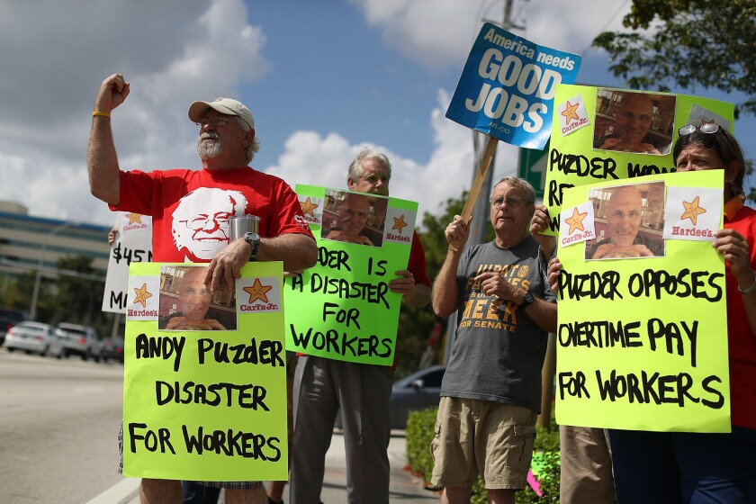 Activists Demonstrate Against Trump's Labor Secretary Nominee Andy Puzder