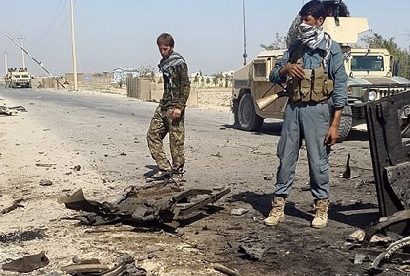 Afghan security forces inspect the site of a U.S. airstrike in Kunduz on Oct. 1.