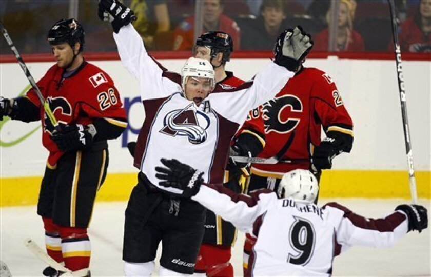 Colorado Avalanche's Paul Stastny, center, celebrates his goal with teammate Matt Duchene, right, as Calgary Flames players skate past during the third period of an NHL hockey game Thursday, Jan. 31, 2013, in Calgary, Alberta. The Avalanche won 6-3. (AP Photo/The Canadian Press, Jeff McIntosh)