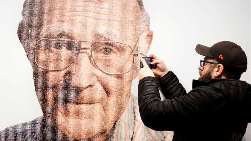 A visitor takes a photo of founder of Swedish multinational furniture retailer IKEA, Ingvar Kamprad, at the IKEA museum, in Almhult, Sweden, on Sunday. Kamprad died Saturday.