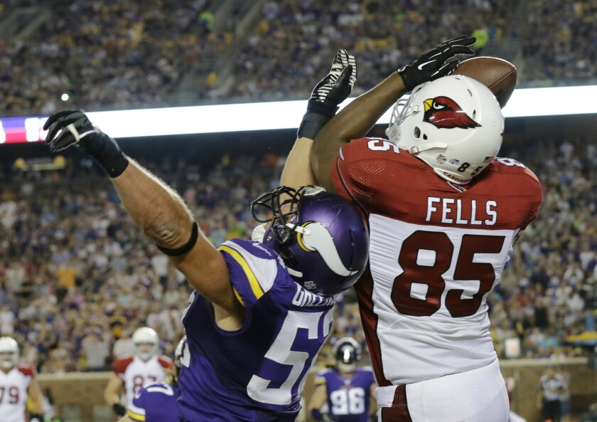 Cardinals tight end Darren Fells catches a 1-yard touchdown pass over Vikings linebacker Chad Greenway during a preseason game Aug. 16. Fells, who opted to play college basketball at UCI instead of football, could play in his first NFL game Sunday.