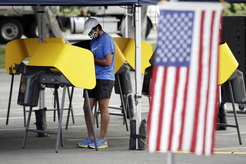 Arjan Walia votes during a special election in Santa Clarita, Calif.