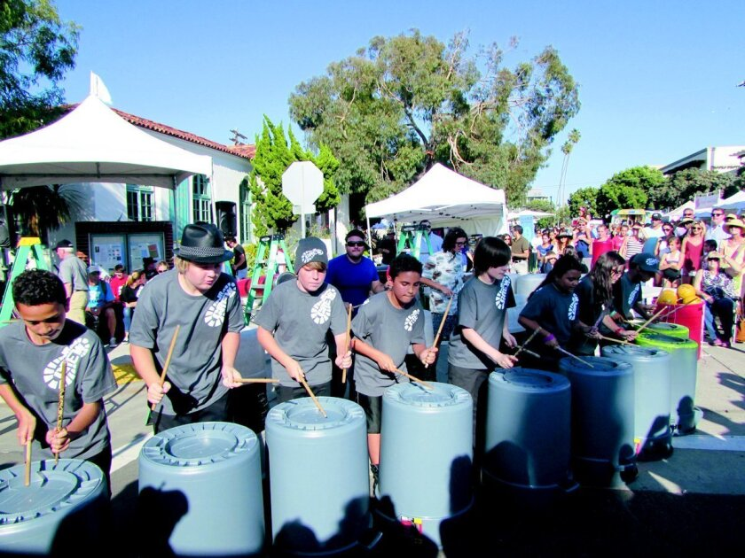 Members of Junior Crew entertain with street beats that attract a bigger and bigger crowd during the 2014 La Jolla Art and Wine Festival. Light File
