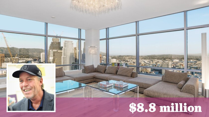 Lakers co-owner Jim Buss has put a corner penthouse in downtown Los Angeles on the market for $8.8 million.