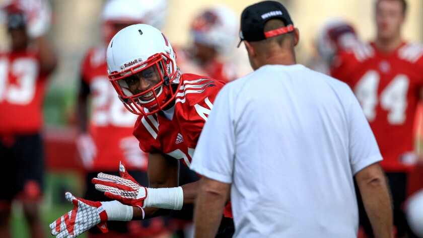 Nebraska cornerback Daniel Davie reacts as Coach Mike Riley interacts with him during a practice on Aug. 6 in Lincoln.