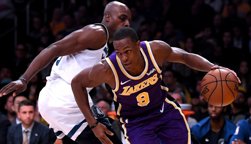 Lakers point guard Rajon Rondo drives around Timberwolves forward Anthony Tolliver during a game Nov. 7.