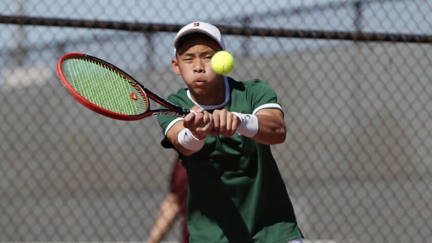 Costa Mesa High's Ethan Votran competes against Estancia in a No. 1 singles set during an Orange Co