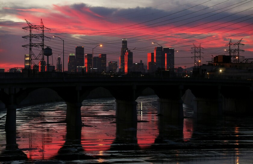 The Los Angeles River reflects late afternoon light as it flows beneath the Soto Street Bridge in Boyle Heights.
