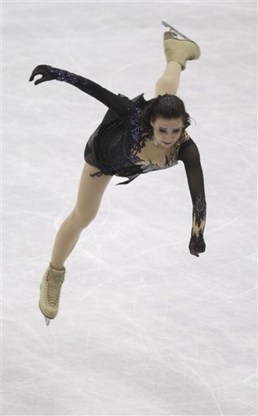 Alena Leonova of Russia performs during her women's free skating program at the 2012 World Figure skating Championships in Nice, southern France, Saturday, March 31, 2012. (AP Photo/Lionel Cironneau)