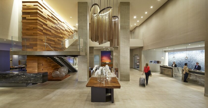 The Hilton San Diego Mission Valley is among a number of hotels that are redesigning their lobbies to make them a more inviting place to work and just hang out.