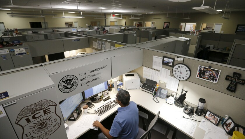 Immigration and Customs Enforcement personnel work at the Pacific Enforcement Response Center in Laguna Niguel in 2017. The facility is an ICE hub from which agents send out detainer requests to authorities.