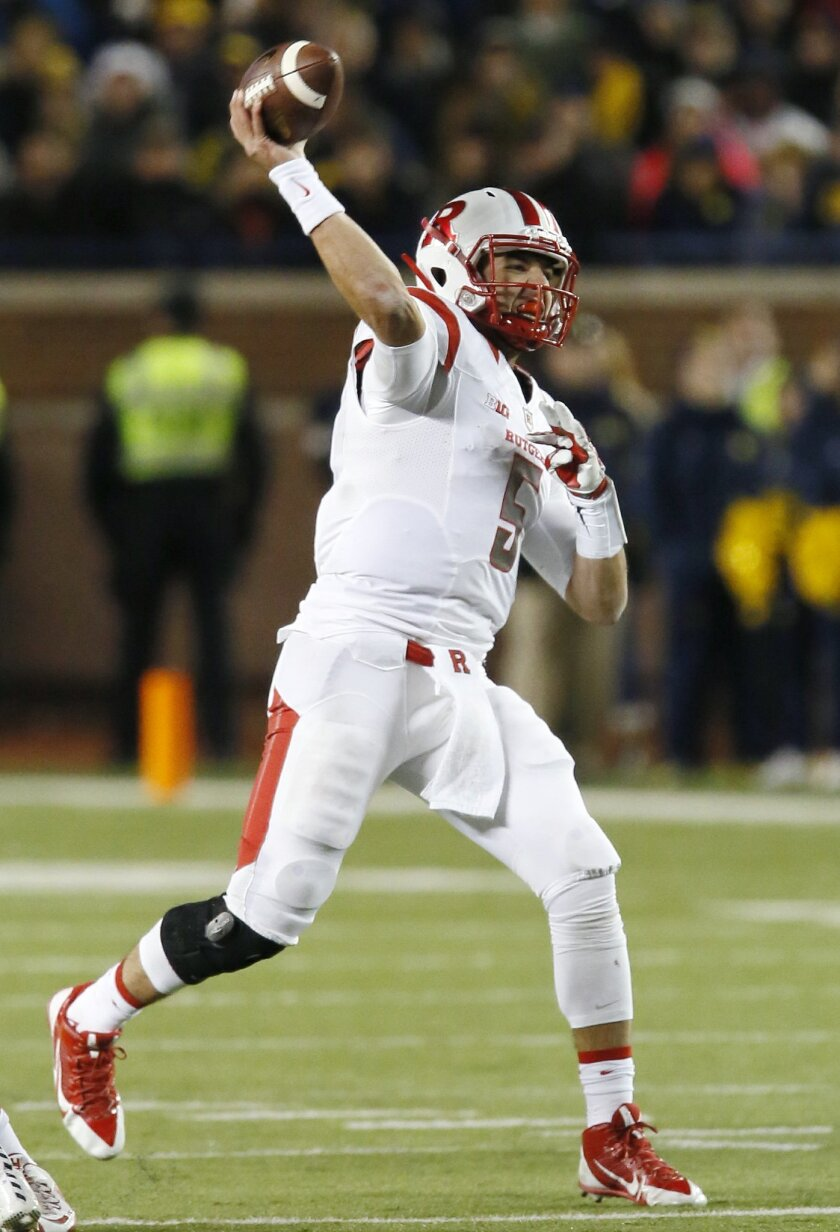 Rutgers' Chris Laviano (5) passes against Michigan during the second half of an NCAA college football game Saturday, Nov. 7, 2015, in Ann Arbor, Mich. Michigan defeated Rutgers 49-16. (AP Photo/Duane Burleson)