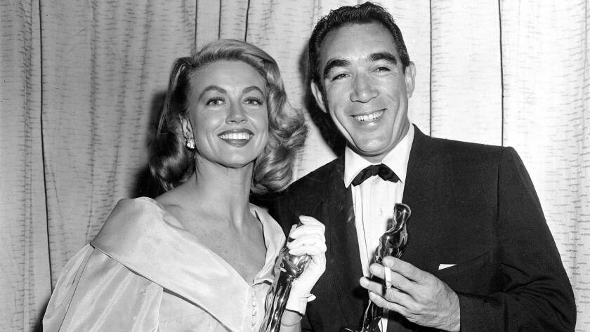 Best supporting Oscar winners Dorothy Malone and Anthony Quinn pose at the Academy Awards.