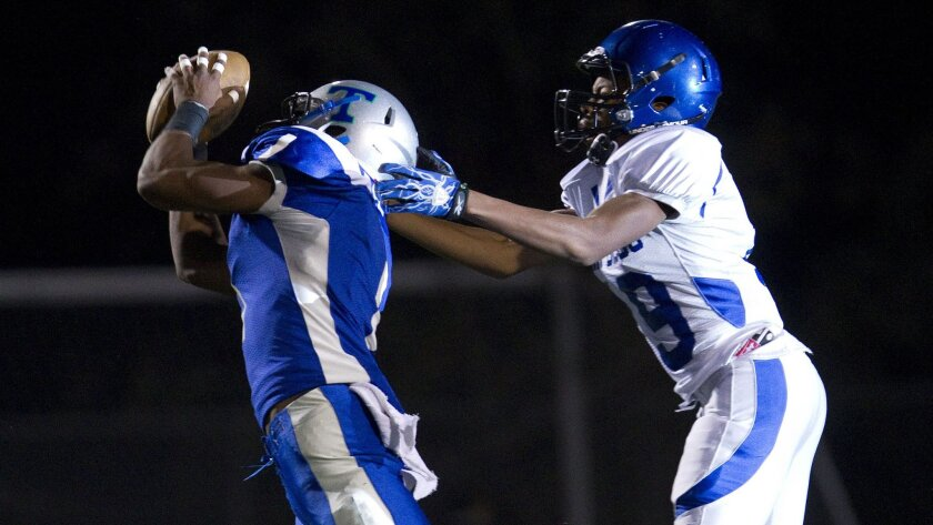 Aaron Baltazar, who also plays running back, intercepts a pass for Eastlake.