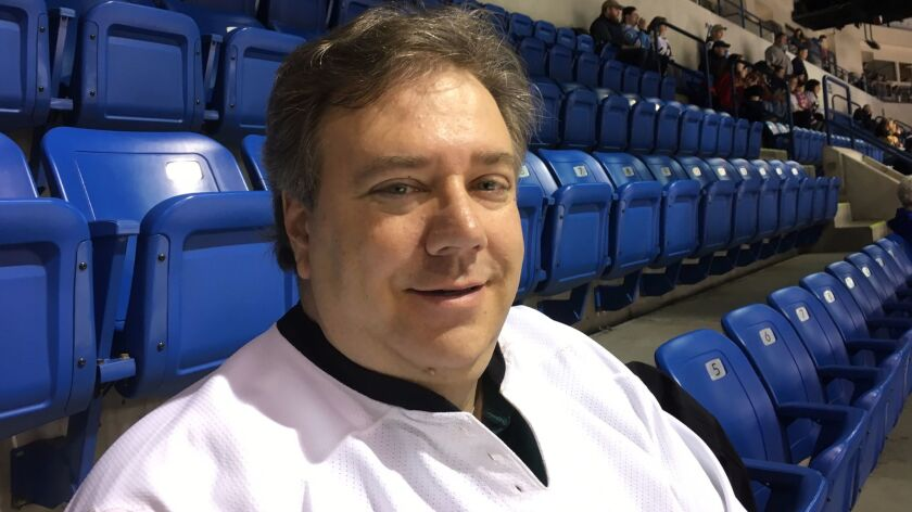 Trump supporter David Ambrulavage attends a minor league hockey game at the Mohegan Sun Arena — where Donald Trump held a rally during the election — in Wilkes-Barre, Pa.