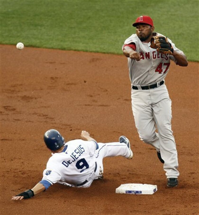 Los Angeles Angels second baseman Howard Kendrick (47) throws to first over Kansas City Royals' David DeJesus (9) to complete a double play in the first inning in a baseball game Wednesday, June, 2, 2010, in Kansas City, Mo. Royals' Billy Butler was out at first. (AP Photo/Ed Zurga)