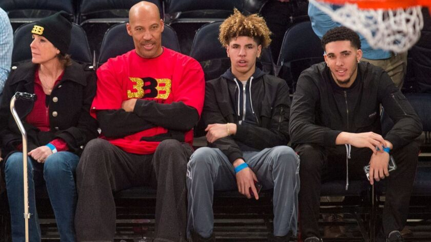 From left, Tina Ball, LaVar Ball, LaMelo Ball and LiAngelo Ball look on as the New York Knicks welcome the Lakers to Madison Square Garden in New York on Tuesday.