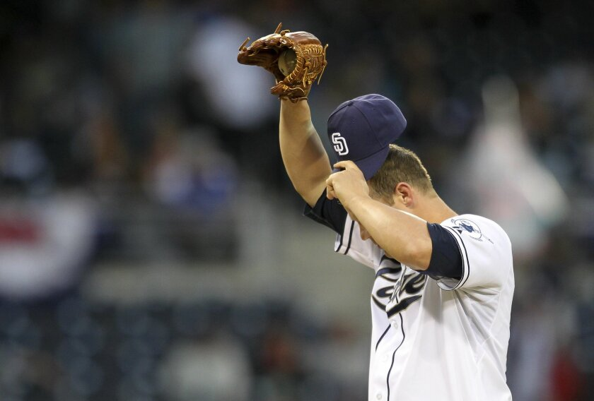 Padres starting pitcher Eric Stults in the first inning reacts to a homerun by Carl Crawford in the first inning.  .