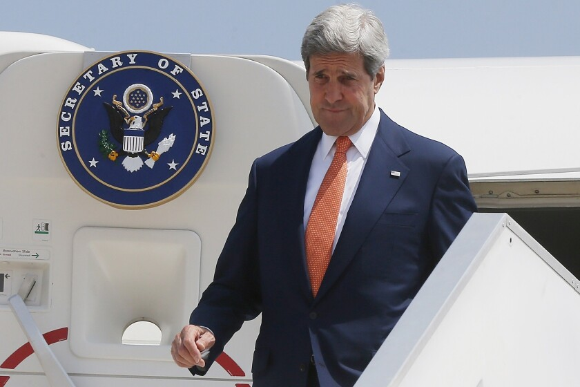 Secretary of State John F. Kerry steps out from his plane at Ben Gurion International Airport as he arrives in Israel on July 23.