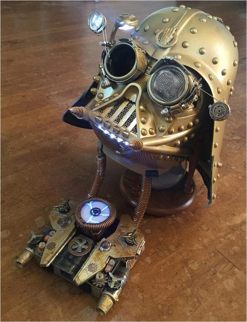Christopher Canole's helmet includes a voice processor with a microphone that makes his voice sound like James Earl Jones as Darth Vader, including heavy breathing and recorded quotes from 'Star Wars.' Chin lights help Canole see while walking, and a suspended reading light above the right eye is s