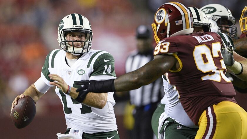 New York Jets quarterback Sam Darnold (14) looks to pass as Washington Redskins defensive end Jonath