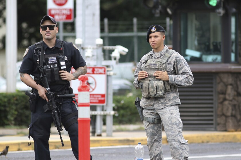 Security stands guard outside the main gate at Joint Base Pearl Harbor-Hickam, in Hawaii