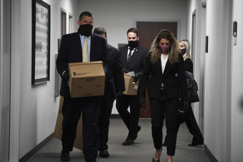 Multiple FBI agents search legislative offices at the Cordell Hull State Office Building in Nashville, Tenn., Friday, Jan. 8, 2021. It's unknown what they are searching for. (Stephanie Amador/The Tennessean via AP)
