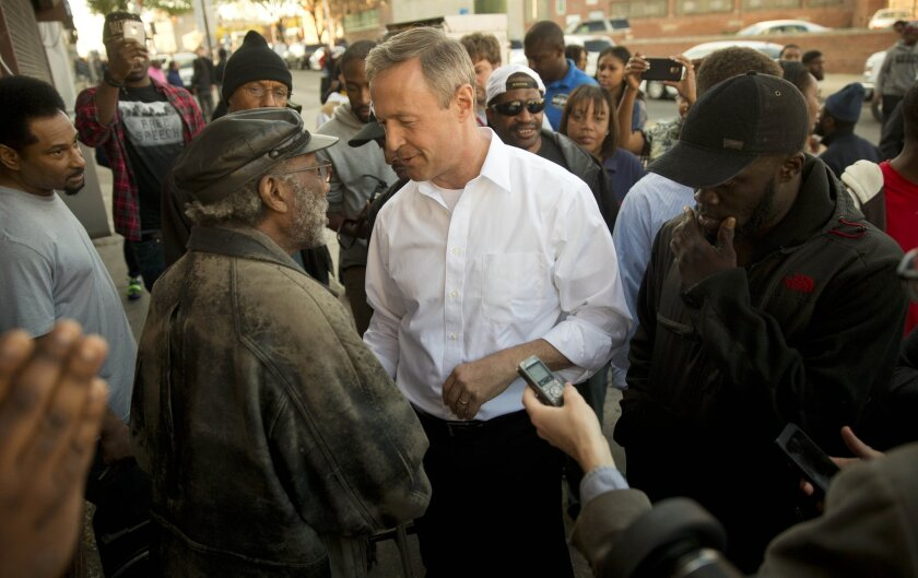 Former Maryland Gov. Martin O'Malley meets with residents n Baltimore on April 28.