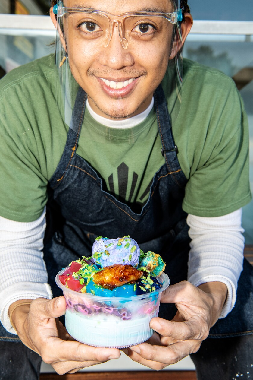 Christian Esteban holds the halo halo from his family's store, Chaaste Family Market in Pasadena.