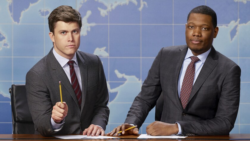 "Colin Jost, left, and Michael Che on NBC's ""Saturday Night Live: Weekend Update Summer Edition."""