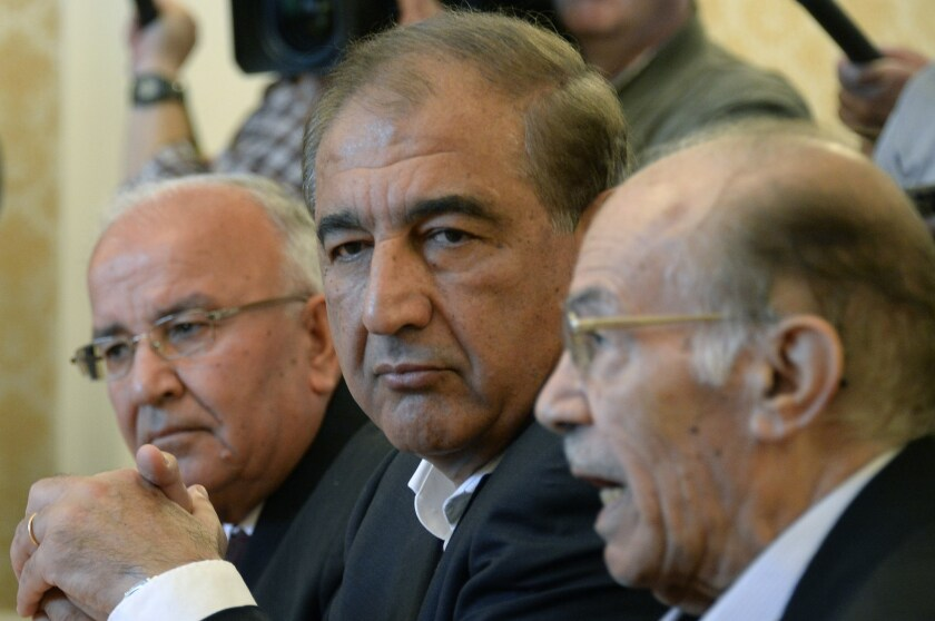 Syria's former deputy prime minister, Qadri Jamil, center, and other members of the Syrian opposition attend a meeting with Russian Foreign Minister Sergei Lavrov in Moscow on Aug. 31, 2015.